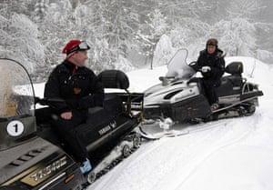 Putin and Medvedev: Vladimir Putin and Dmitry Medvedev drive snowmobiles