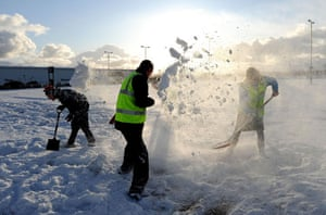 Winter weather: Staff take time out from clearing the car parks to have a snow fight