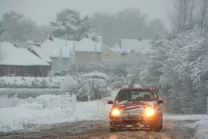 Winter weather: Chieveley, Berkshire, January 6: A car drives through the snow