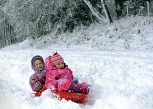 Winter weather: Hartley Wintney, Hampshire, 6 January: Children sledge