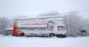 Winter weather: Four Marks, Hampshire, 6 January:  An abandoned bus sits on the A31
