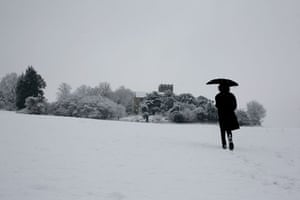 Winter weather: Addington, Kent, 6 January: A woman walks in a snow shower