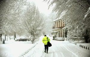 Winter weather: Hartley Wintney, Hampshire: An ambulance man walks away