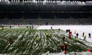 Helpers at St.James' Park clear the snow from the pitch before the Barclays Premiership match between Newcastle United and Charlton Athletic on December 28, 2005