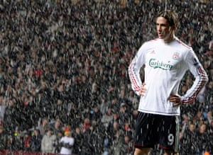 Liverpool's Fernando Torres stands in the snow during their English Premier League soccer match against Aston Villa at Villa Park in December 2009.