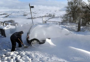 Winter weather: Oldham, Lancashire: Cars are dug out of deep snowdrifts