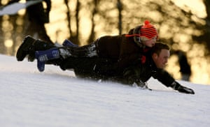 Winter weather: Nottingham: People sledging in Wollaton Park
