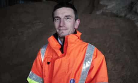 Jason Humm, area manager at the Gloucestershire Highways depot, in front of salt and grit mountain