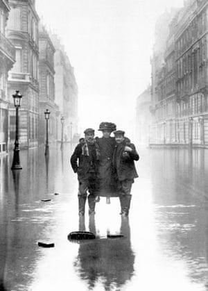 Paris flood: Two men carrying a woman