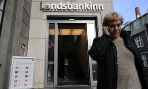 A woman leaves a branch of Iceland's second largest bank, Landsbanki