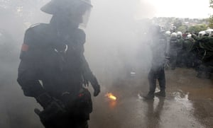 Stuttgart 21 Protest: Policemen walk through smoke from a flare during a protest in Stuttgart