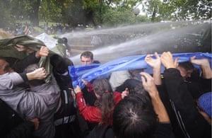 Stuttgart 21 Protest: Demonstrators try to protect themselves against water canons Stuttgart