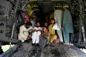 Swat: Flood-stricken villagers being evacuated in an American Chinook helicopter