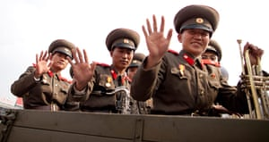 North Korea: North Korean Army Bandmembers wave as they leave the Kim Il-Sung Square
