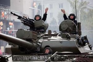 North Korea: North Korean tank crews wave to the crowds