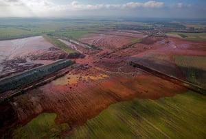 Hungary toxic sludge: An aerial view of the broken dyke of a reservoir containing red mud