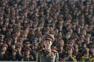 North Korea night square: Military watch the night dancing in Kim Il-Sung Square