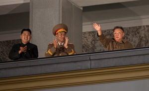 North Korea night square: Kim Il-Sung Square Kim Jong-il and his son Kim Jong-un