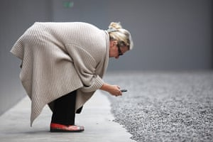 Turbine Hall: Lady takes close up of the Seeds