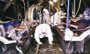 Police forensic officers comb the wreckage of one of the 7/7 tube trains