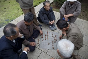 Dan Chung: Old men play Korean Chess near the Party Foundation Monunment in Pyongyang
