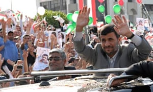 Mahmoud Ahmadinejad waves to the crowds on his arrival in Beirut