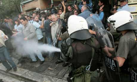 Greek riot police use teargas to disperse protesting workers at the Acropolis in Athens