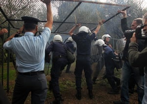 Protest at Acropolis: Riot police use a side entrance to enter the compound