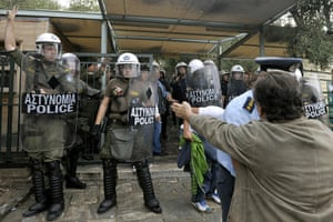 Protest at Acropolis: A Culture ministry protester shouts at riot police at the Acropolis