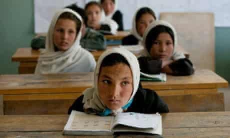 Afghan girls listen during class at the Markaz high school in Bamiyan, Afghanistan