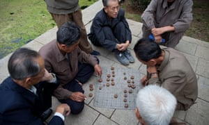 Old men play Korean Chess near the Party Foundation Monunment in Pyongyang.