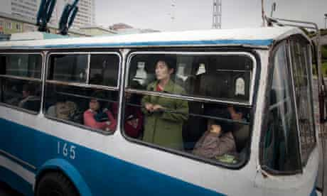 Tired commuters cross Pyongyang on an old bus.
