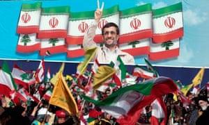 Hezbollah supporters wait for Iranian president, Mahmoud Ahmadinejad in Bint Jbeil, Lebanon