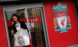 A woman exits Liverpool football club shop