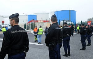 France Strikes: Gendarmes stand in front of striking employees of a fuel dept near Toulouse