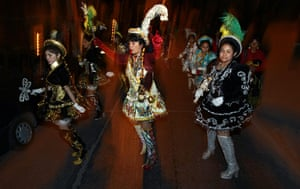 chile miners go home: Women dance during a costumes parade for the rescued miners in Copiapo