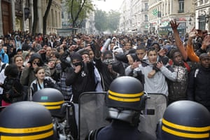 France Strike Update: High school students face police officers during a demonstration in Lyon