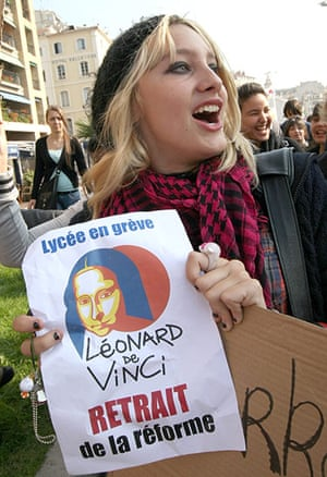 France Strike Update: A student holds a placard on strike in Marseille