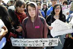 France Strike Update: A high school student holds a placard in Marseille