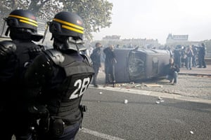 France Strike Update: An overturned car during a demonstration against retirement reforms in Lyon