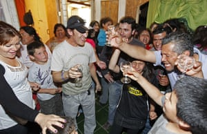 Chile miners return home: Ticona toasts with family and friends upon arriving home in Copiapo