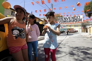 Chile miners return home: Neighbors of miner Luis Urzua chat at a welcome party