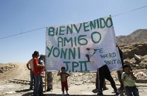 Chile miners return home: Neighbors of rescued miner Barrios erect a banner