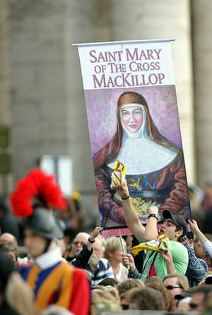 Canonisation ceremony: Australian pilgrims hold a banner showing Sister Mary MacKillop