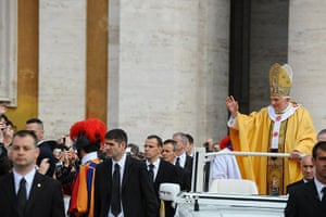 Canonisation ceremony: Pope Benedict XVI waves to the faithful as he arrives
