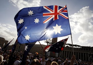 Canonisation ceremony: Australian pilgrims wave flags before a solemn mass