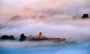 Early morning mist carpets the valley of the north Tyne river