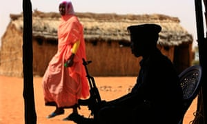 A policeman guards a polling station in Sudan in April 2010