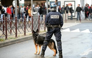 strikes in france: A police dog handler stands in front of