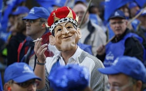 strikes in france: A man wears a mask of  President Sarkozy